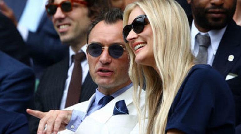 Актер Джуд Лоу и его новая жена. Фото: Clive Brunskill