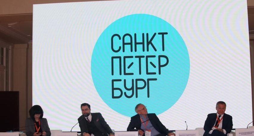 Вера в озарение: Смольный показал логотип Петербурга — бирюзовое солнце
